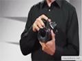 Holding the Canon 5D Mark III camera - English